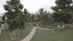 Drove view around garden compound including pond - stock footage
