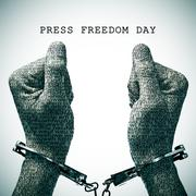 handcuffed man and text press freedom day - stock photo