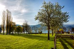 Lake Attersee in the morning in springtime Stock Photos