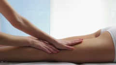 Therapeutic female leg massage Stock Footage