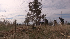 Students plant trees on Earth Day in Markham Canada v39 Stock Footage
