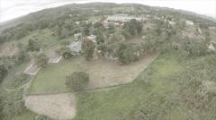 Drone view - Birds fly around garden compound Stock Footage