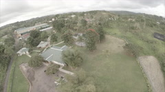 Drone view of compound on mountain - stock footage