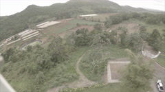 Drone view of compound on mountain 2 - stock footage
