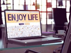 Enjoy Life Concept on Laptop Screen Stock Illustration