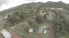 Drone over complex on a cloudy day - Caribbean Stock Footage