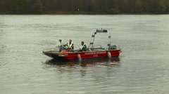 Firefighter lifeboat patrolling on River Rhine Stock Footage