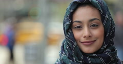 Young woman wearing hijab in city serious to smiling face portrait Arkistovideo
