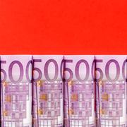 500 euro row on red background - stock photo