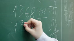 A pupil solves math on the chalkboard at primary school, Full HD shot - stock footage