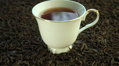 Hot tea in a porcelain cup Stock Footage