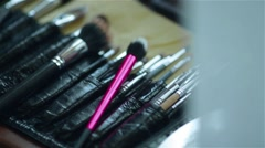 Closeup shot of make up brushes. Camera moving slowly shooting the kit. Stock Footage
