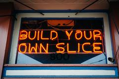 Build Your Own Slice sign in Fells Point, Baltimore, Maryland. Stock Photos