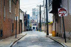 Narrow alley in Midtown-Belvedere, Baltimore, Maryland. Stock Photos