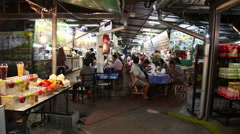Street food on night market in Chiang Mai - stock footage