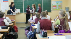 Back view of elementary school students in the classroom, Full HD shot Stock Footage