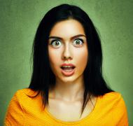 Surprised face of amazed shocked woman - stock photo