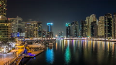 View of Dubai Marina Towers and yahct in Dubai at night timelapse hyperlapse Stock Footage