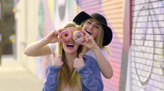 Fun Teens Pose With Donuts, They Cover Their Eyes And Make Funny Faces Stock Footage