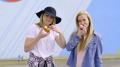 Teens Eat Donuts, One Girl Turns Hers Into A Smile And Poses For Camera Stock Footage