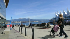 Pedestrians Enjoying Sunny Day In Vancouver Near Canada Place Stock Footage