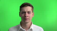 Young businessman amazed surprised confused on greenscreen - stock footage