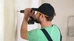 Renovation: man using an electric hand drill. Close up. Slow motion Stock Footage