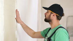Renovation: man marking the wall. Slow motion - stock footage