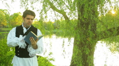 Victorian 18 century poet reading book Stock Footage