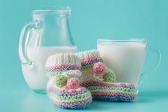 Glass of the milk on plain aquamarine background Stock Photos