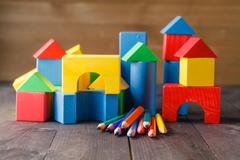 Different colors of pencils ontable with building blocks Stock Photos