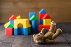 Retro Bear toy alone on wooden floor Stock Photos