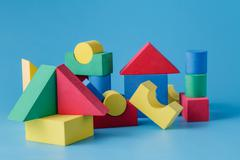 The toy castle from color blocks on  blue background - stock photo