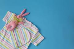 Baby clothes for newborn. In pastel colors Stock Photos