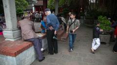 Men playing board game in park, Ha Noi, Vietnam Stock Footage