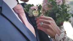 Bride holding fiance's flower. Stock Footage