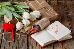 I love you phrase in notebook with flowers on table Stock Photos