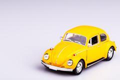 Yellow car, beetle on white, hippie car Stock Photos