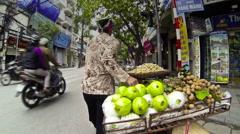 Fruit seller walk street Stock Footage