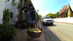 Fruit seller walk street Stock Footage