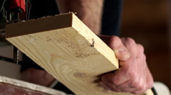 Man with electric jigsaw cutting a piece of wood. Close up. Slow motion Stock Footage