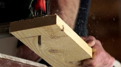 Man with electric jigsaw cutting a piece of wood. Close up. Slow motion - stock footage