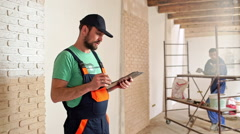 Renovation: man is measuring and taking notes - stock footage