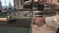 Young couple playing in table football Stock Footage