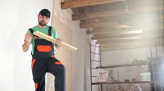 Renovation: foreman at work. Slow motion - stock footage