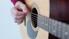 Man playing an acoustic guitar close up Stock Footage