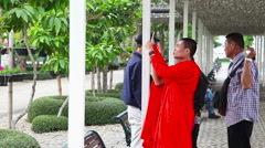 Monks and visitors at Wat Rong Khun temple Stock Footage
