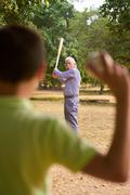 Happy Family Senior Grandpa and Grandson Boy Playing Baseball - stock photo