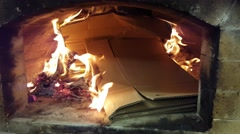 Burning cardboard boxes, inside a big wood heated oven Stock Footage