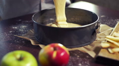 Baking cake. Cake batter pouring in baking pan. Home baking. Baking ingredients Stock Footage
